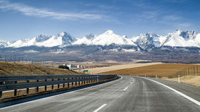 Empty highway and Tatra mountains, Slovakia Stock Images