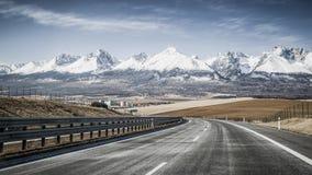 Empty highway and Tatra mountains, Slovakia Royalty Free Stock Photography