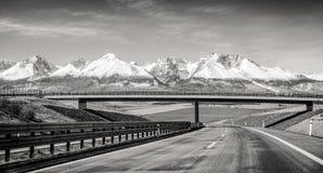 Empty highway and Tatra mountains, Slovakia Stock Image