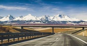 Empty highway and Tatra mountains, Slovakia Stock Photos