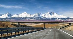 Empty highway and Tatra mountains, Slovakia Royalty Free Stock Photo