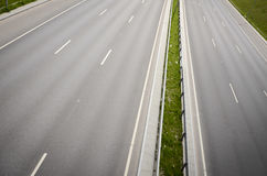 Empty highway. With three lanes each direction Stock Photo
