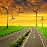 Empty Highway with wind turbines Stock Image