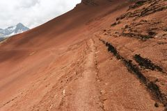 Empty hiking trail. On red mountain slope in Peruvian Andes stock images