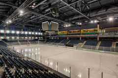 Empty hockey arena. Empty stands of a large college hockey arena royalty free stock photography