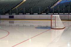 Empty hockey goal on ice rink. Side view. Empty ice hockey playground - the view from behind the gate Royalty Free Stock Photography