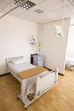 Empty hospital bed in room Stock Image