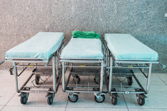 Empty hospital bed. Three empty hospital bed on walkway Stock Image