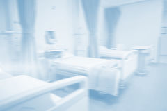 Empty hospital beds in hospital Stock Images