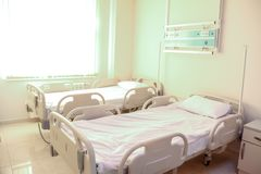 Empty Hospital or clinical room with comfortable beds. Empty Hospital or clinical room with comfortable beds and windows with sun light royalty free stock images