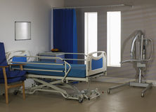 empty hospital ward with bed chair and hoist Stock Images