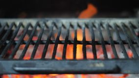 Empty hot cast iron grill with glowing coal and josper smoke stock video