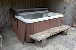 Empty hot tub. Waiting to be used stock photos