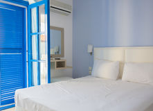 Empty hotel room in traditional mediterranean style with blue bl Royalty Free Stock Image