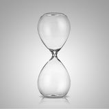 Empty hourglass. On gray background Stock Photos