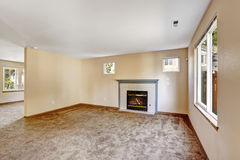 Empty house interior. Bright ivory living room with fireplace Stock Photography