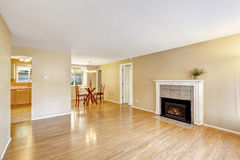 Empty house interior with cozy fireplace and dining area Royalty Free Stock Photos