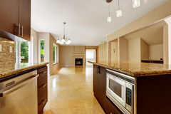 Empty house interior with kitchen area. Marble tile floor Royalty Free Stock Photography
