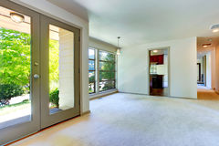 Empty house interior. Living room with door to backyard Royalty Free Stock Image