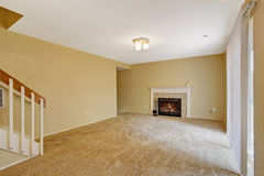 Empty house interior. Living room with fireplace Royalty Free Stock Images