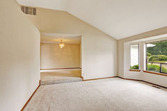 Empty house interior with open floor plan. Bright room with wind Royalty Free Stock Photos