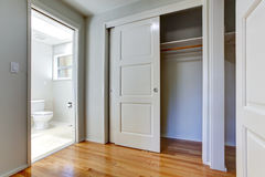 Empty house interior. View of closet and bathroom. Empty house interior with hardwood floor. View of open door to closet and bathroom Royalty Free Stock Photography