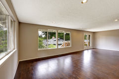 Empty house in light ivory color with hardwood floor Royalty Free Stock Photography