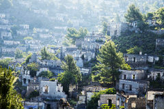 Empty houses at ghost town village Kayakoy ruins near Fethiye Royalty Free Stock Photo