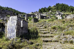 Empty houses at ghost town village Kayakoy ruins near Fethiye, Turkey Royalty Free Stock Images