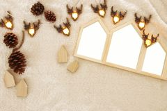 Empty houses shape wooden photo frames over cozy and warm fur carpet. For photography montage. Top view Stock Photo