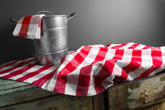 An empty ice bucket on a checkered tablecloth Royalty Free Stock Images