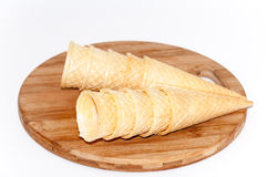 Empty ice cream cone on a wooden board Stock Images