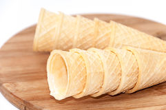 Empty ice cream cone on a wooden board Stock Photos