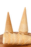 Empty ice cream cone on a wooden board Royalty Free Stock Images