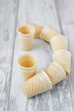Empty ice cream cones. On the old wooden background. capacitance for ice cream Stock Image