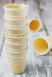 Empty ice cream cones. On the old wooden background. capacitance for ice cream Stock Photography