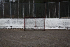 Empty ice hockey goal. Outdoors in front of boards on sand, autumn in Finland Stock Images
