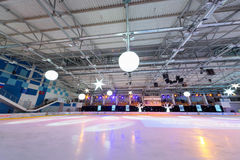 Empty ice stadium with spotlights. MOSCOW - DEC 14: Empty ice stadium with spotlights at Ice Palace Mechta, on Dec 14, 2012 in Moscow, Russia Royalty Free Stock Photography