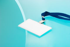 Empty ID tag on blue background Royalty Free Stock Photo