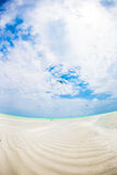Empty idyllic tropical beach with white sand and perfect turquoise water Stock Photos
