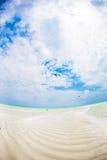 Empty idyllic tropical beach with white sand and perfect turquoise water. Idyllic tropical beach with white sand and perfect turquoise water Stock Photos