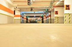 Empty underground parking. Empty illuminated underground parking at the city mall Stock Photos