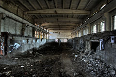 Empty industrial room. Empty industrial decayed room with large tube in the concrete wall Stock Photo