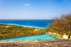 Empty Infinity Pool Overlooking Tropical Water Stock Image