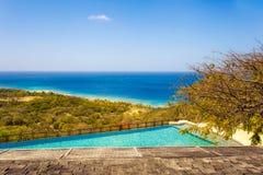 Empty Infinity Pool Overlooking Tropical Water Stock Image