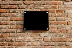 Empty information sign on old brick wall. Royalty Free Stock Photo