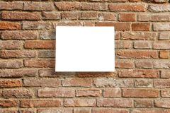Empty information sign on old brick wall. Stock Image