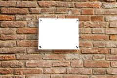 Empty information sign on old brick wall. Royalty Free Stock Photos