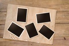 Empty instant album on wood table Stock Photography