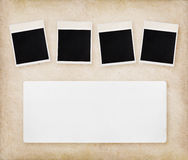 Empty instant photos on paper texture Stock Images
